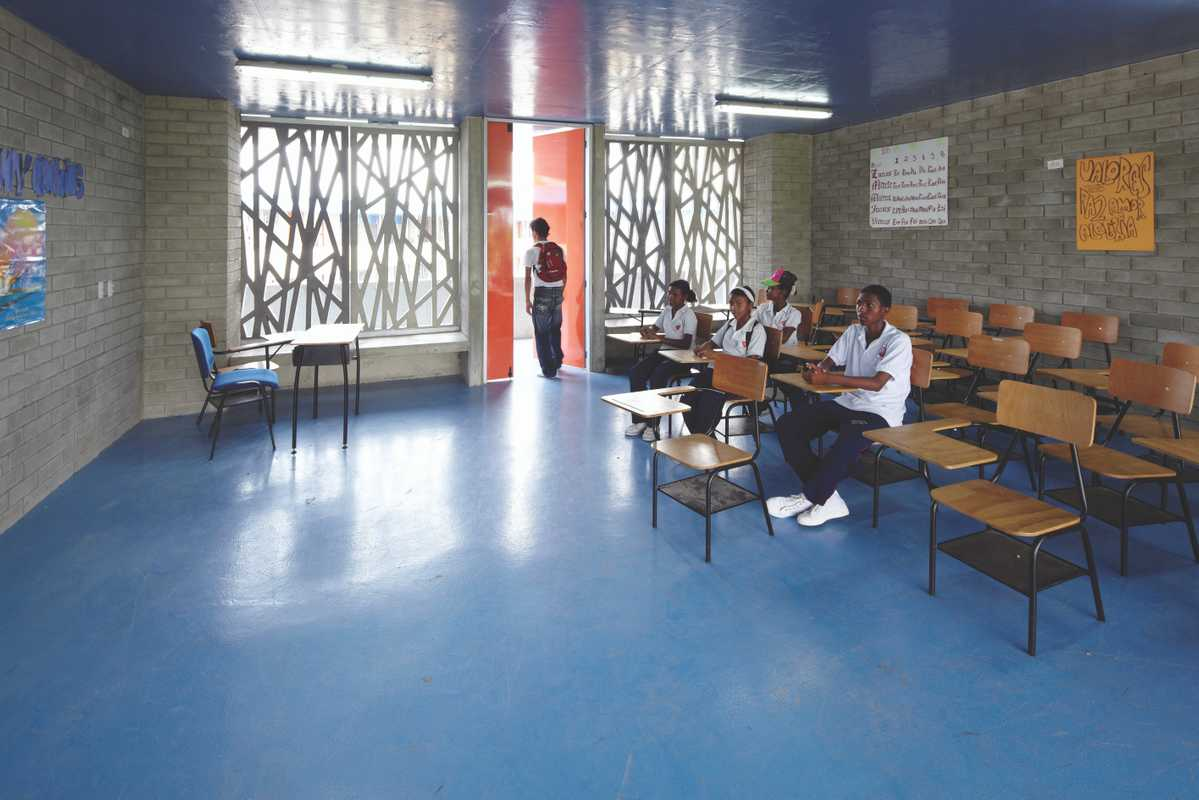 Classrooms are airy and light; they also use Colombian wooden furniture
