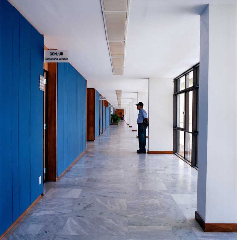 In the main annex each floor has wall panels in a different colour. The security guard does not always match the decor