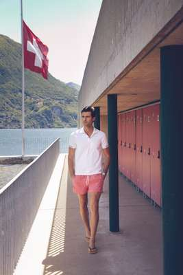 Polo shirt by Zegna Sport, swim trunks by Canali, flip flops by Havaianas, watch by Audemars Piguet