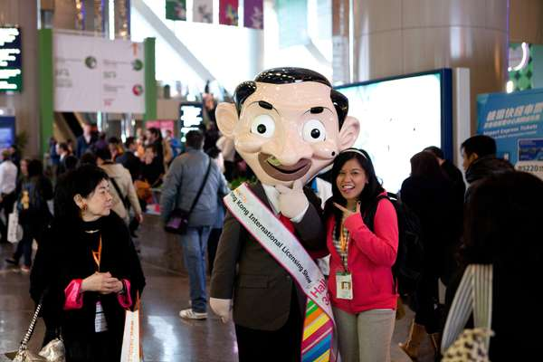 Visitor posing with fair mascot