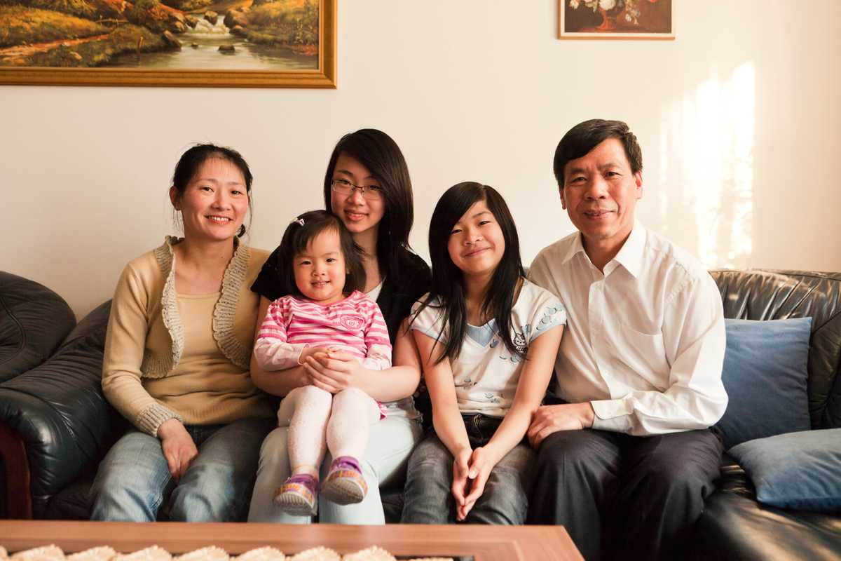 Nguyen Quoc Hung at home with his family