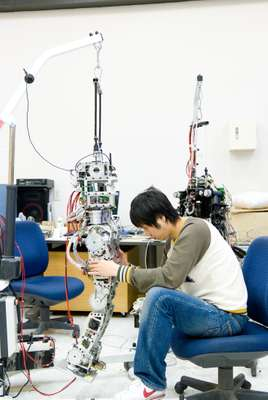 Student working on a humanoid robot prototype
