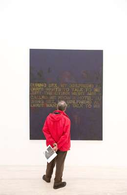 Visitor observing a Richard Prince work