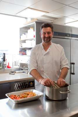 Chef Emmanuel Lejeune prepares lunch for the chief editors