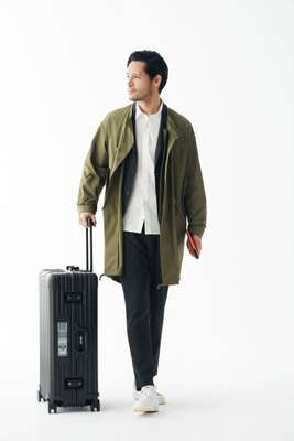 Coat by Pine, jacket and trousers by United Arrows, shirt by Head Porter Plus, trainers by Adidas Originals, suitcase by Rimowa, passport case by Porter