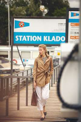 Coat by Tomorrowland Collection, top by Agnona, trousers by Salvatore Ferragamo, shoes by Roger Vivier, bag by Valextra