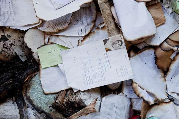 Personal files lie strewn on the floor of police station in La Goulette