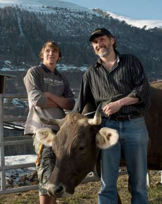 Imfield with his son Samuel and Erika the pregnant cow