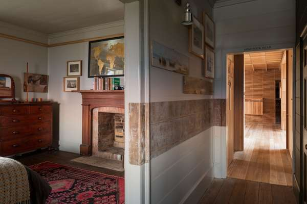 The central passage divides the original bedrooms
