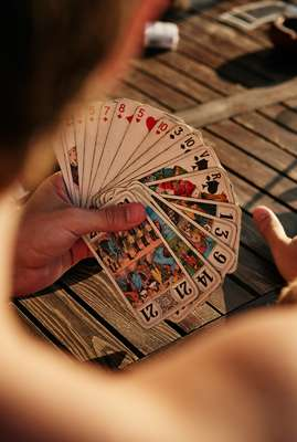 Students play a game of Tarot