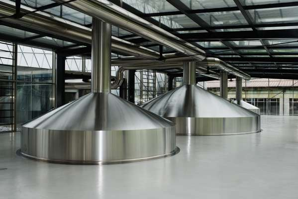 Stainless steel vats in Forst's new brew house