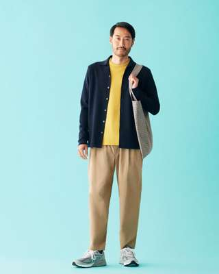 Cardigan by Loro Piana, jumper by Batoner, trousers by Scye, socks by Uniqlo, trainers by New Balance, bag by Mfpen from 1LDK