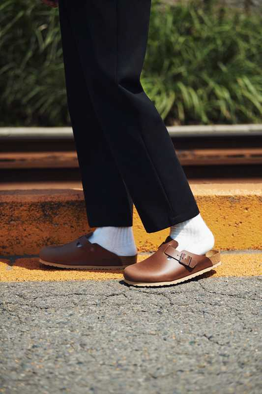 TROUSERS by Studio Nicholson, SOCKS by Tabio, SANDALS by Birkenstock
