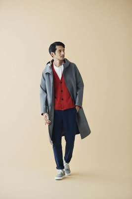 Coat by Mackintosh,  cardigan and trainers by Beauty  & Youth, t-shirt by Woolrich, trousers  by Colmar, socks by Muji