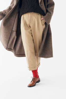 Coat by Tod's, rollneck jumper by Loro Piana, trousers by Scye Basics, socks by Rototo, shoes by Church's