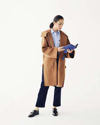 Coat and trousers by Sofie D'Hoore, shirt by Jacob Cohën, shoes by JM Weston, travel wallet by Valextra