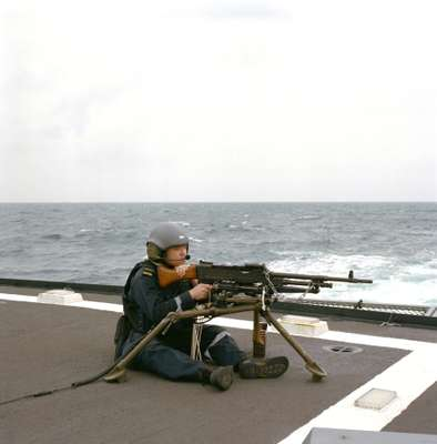 Manning a machine-gun on the heli-deck