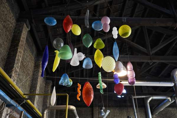 Glass pendants decorate Gambaro & Tagliapietra's workshop