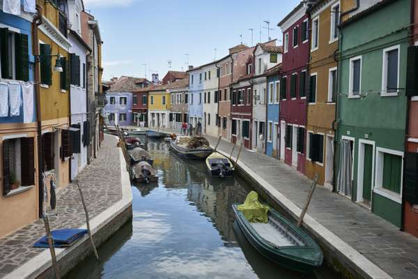The canals of Murano are lined with  glassware shops