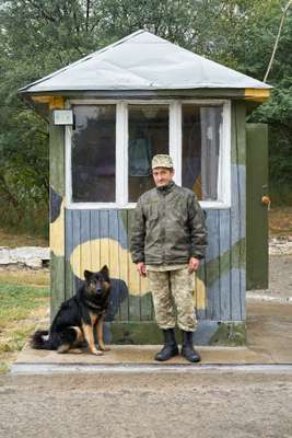 Ukrainian guard at the entrance of the centre in Kamianets-Podilskyi