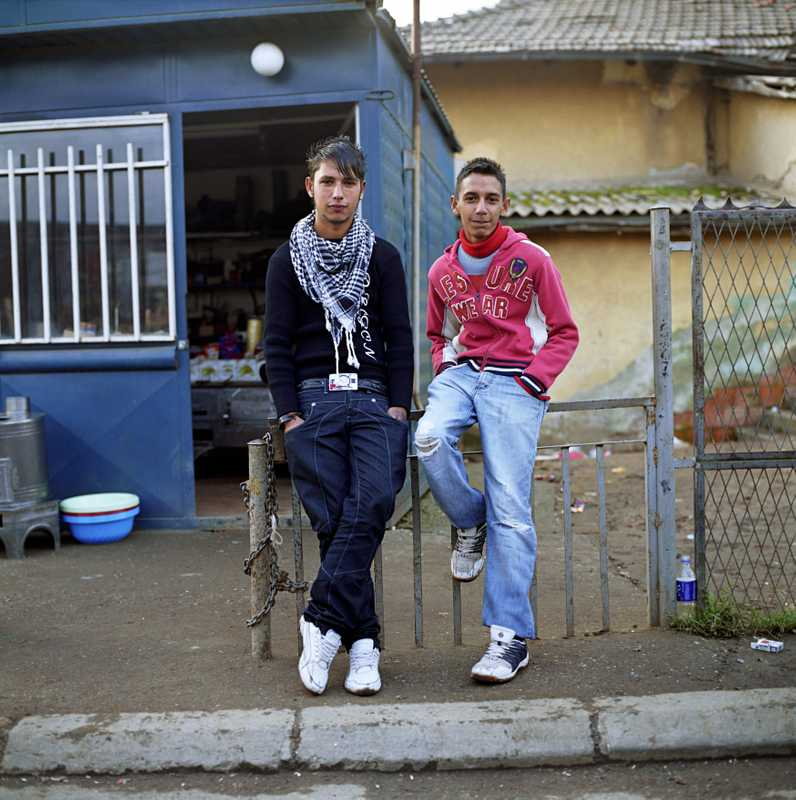 Qefser, 18, and Salmir, 17, pose in a Roma district outside of Pristina