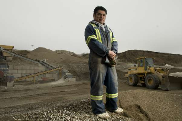 Worker Louis Baptiste in the gravel pit at the Oliver Readi-Mix site, British Columbia, an Osoyoos project