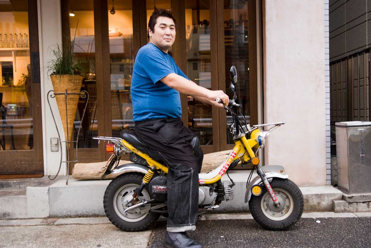 Dai Nagao, 39, a restaurant owner with his customised Yamaha Chappy on his way through Yoyogi-uehara. He uses this scooter while sourcing food for restaurants. He has been a scooter rider for seven years