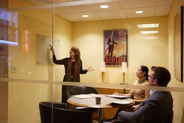 Peru-born instructor Carmen López teaching a Spanish class
