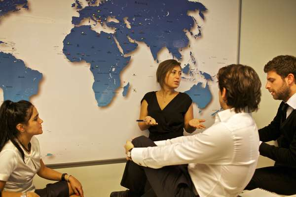 Özlem Özsümbül and her team discuss global sales strategy
