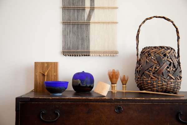 Art objects including wooden clock by Bob Stocksdale and ceramic vessels by Toshiko Takaezu