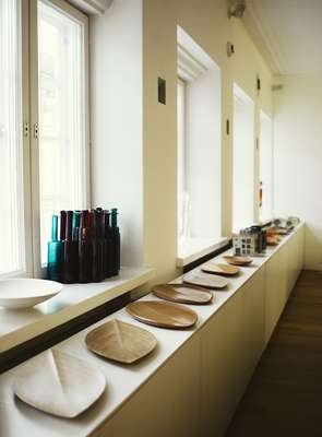 Plywood plates by Tapio Wirkkala, glass bottles by Nanny Still, Rut Bryk ceramic art pieces