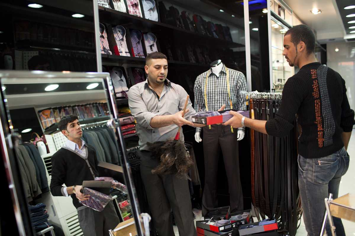 Walid Sultani, Saif Samir and Hassenin Asad at their men's clothing shop