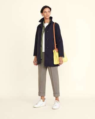 Coat by Sealup, jacket by Auralee, sweatshirt by Colmar, trousers by Bottega Veneta, trainers by Golden Goose Deluxe Brand, earrings by Miansai, bag by Hermès