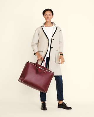 Coat by Agnona, pullover by Cos, jeans by Roy Roger's, shoes by GH Bass & Co, watch by Hermès, bag by Valextra