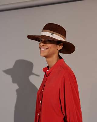Shirt by Holland & Holland, hat by Maison Michel