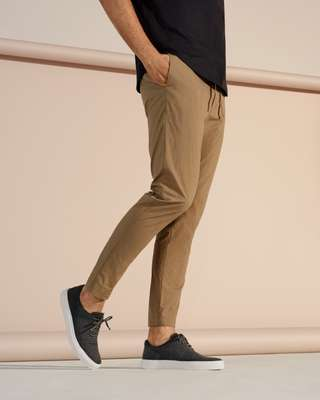 Short-sleeved pullover by Scye, trousers by Undecorated Man, trainers by AMB
