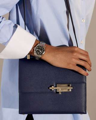 Shirt by Monographie, watch by Tudor, bag by Hermès
