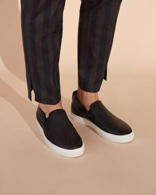 Trousers by Aile from Édifice, shoes by Emporio Armani