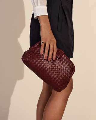 Shirt by Massimo Alba, shorts by Vince, bag by Bottega Veneta, ring by Dina Kamal