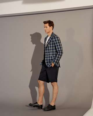 Jacket by Orazio Luciano, t-shirt by Wild Life Tailor,  shorts by Itty-Bitty, shoes by JM Weston