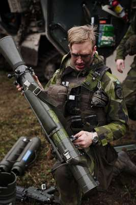 Soldier attending to a recoilless rifle