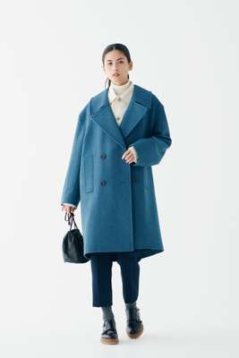 Coat by Uniqlo U, jacket by Kidur, rollneck jumper by Norse Projects, trousers by Maison Kitsuné, socks by Sunspel, shoes by Santoni, bag by Scye