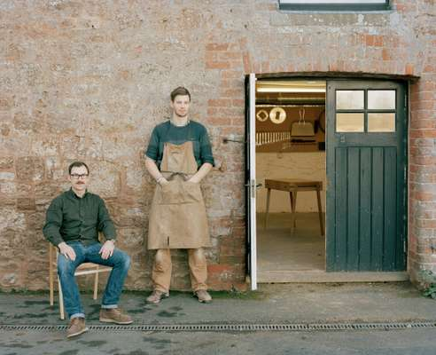 Young and Norgate founders Dave Young (left, seated) and Ross Norgate (right, standing)