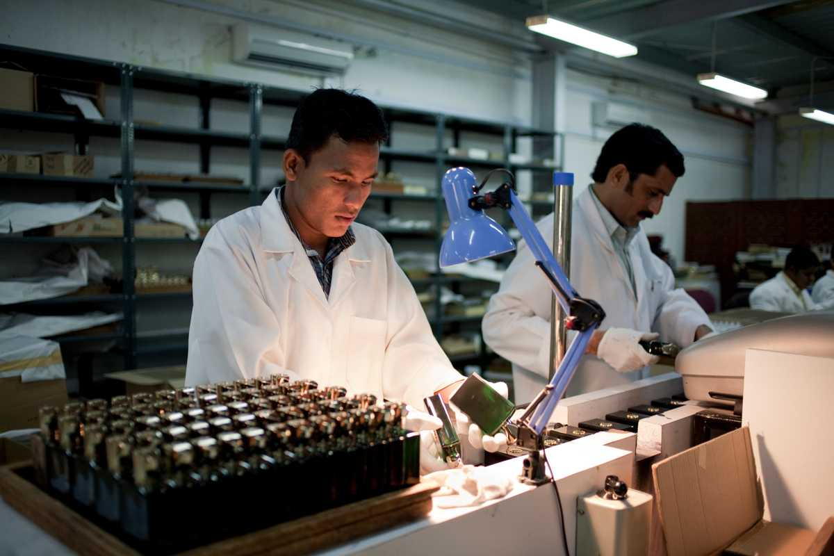 Workers at the Amouage bottling plant. The Omani perfume is one of the country's best-known exports