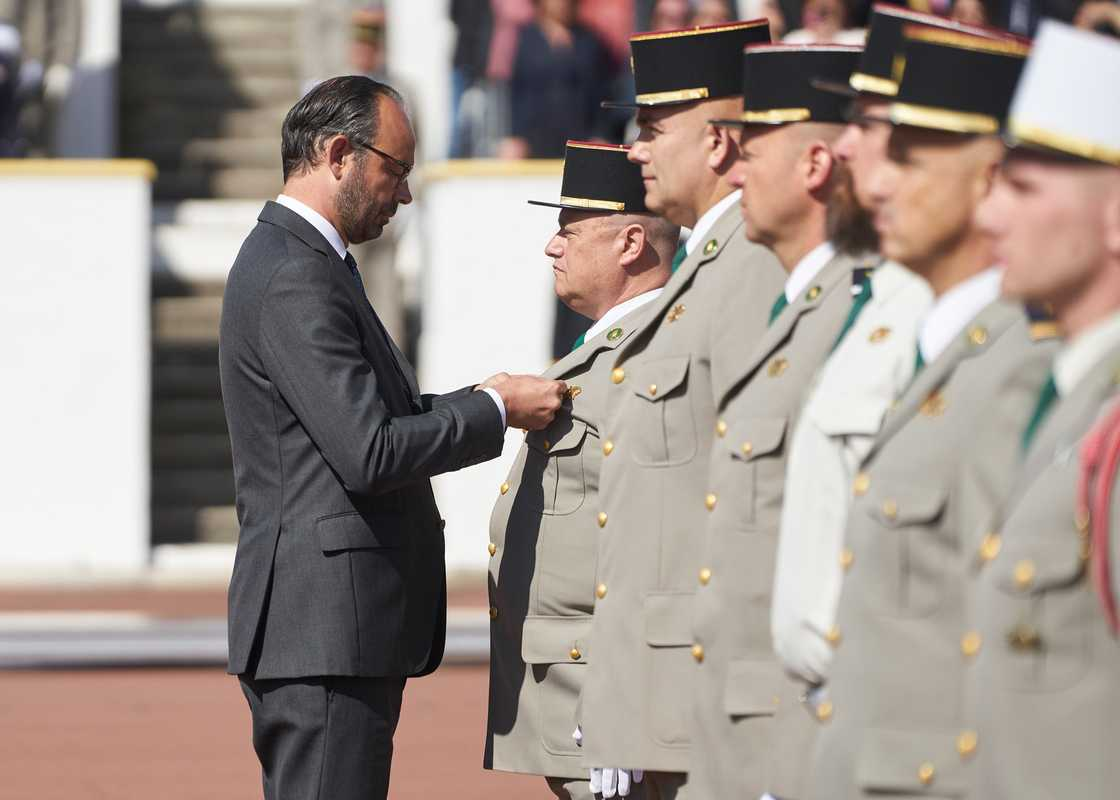 Philippe awarding medals of service. He also issued two decrees of French naturalisation
