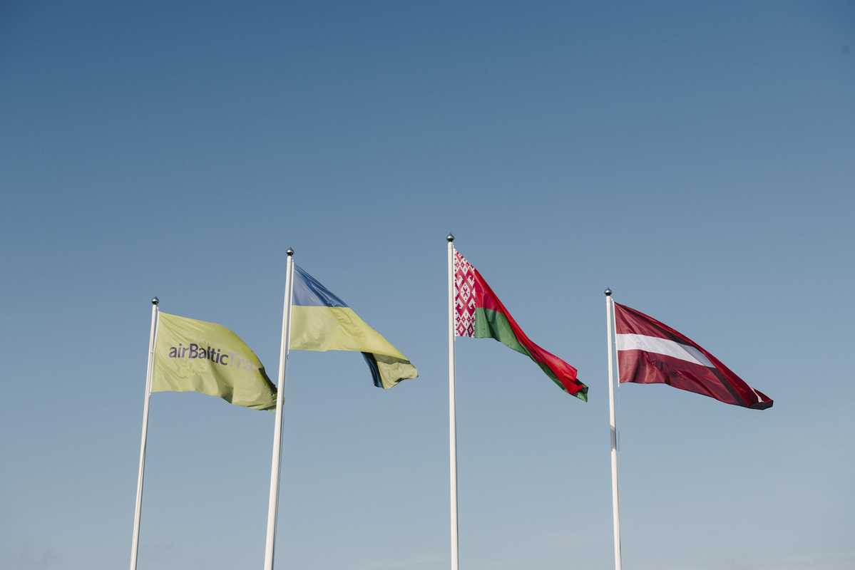 Flags of Latvia, Belarus and Ukraine (and the airline) flying over Riga Airport
