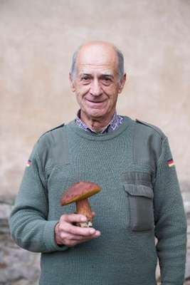 Silvano Bartoli collecting mushrooms