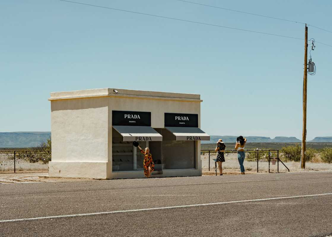 Austin girls pose at Elmgreen & Dragset's Prada Marfa outside Valentine