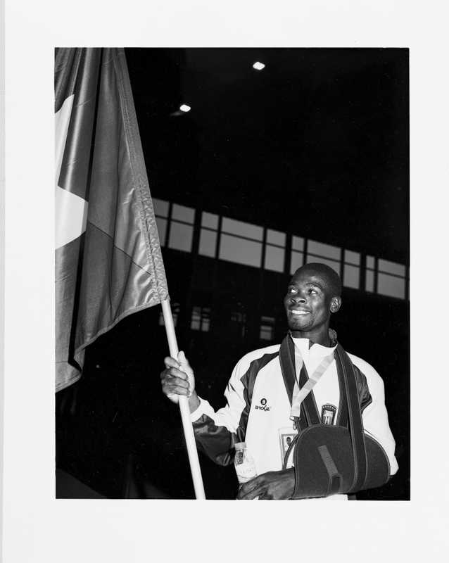 Guinea Bissau athlete proudly carries his flag