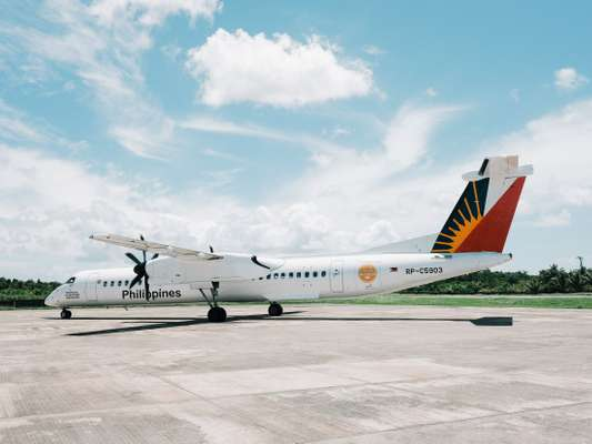 Philippine Airlines plane taxiing at Siargao Airport